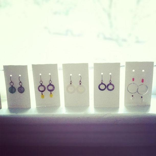 earrings lined up in the window